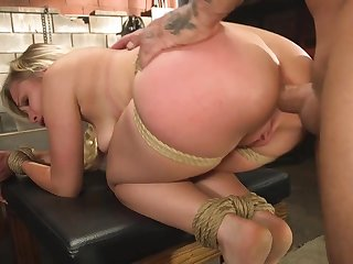 Stunning blonde girl is tied and fucked in the basement
