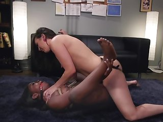 White babe is using a strap-on on her black girlfriend