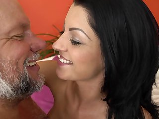 A grandpa that loves sexy bitches not far from hot asses is kissing this one
