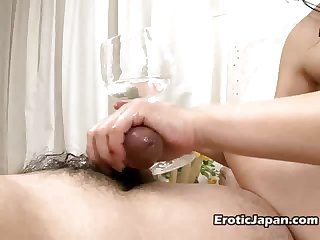 Sexual Japanese young doll Rui Natsukawa massaging two oiled cocks with her feet