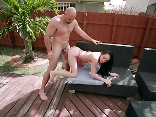 Slutty brunette is fucking with her neighbor in the yard
