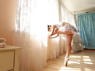 Slender Russian ballerina Nino Belover does the splits listen to snaked
